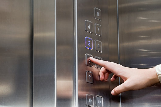 pressing lift buttons